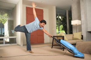 man enjoying vacuuming